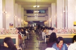 Students share a moment of intimacy while eating together at the student cafeteria during the official lunch time 20 years ago.