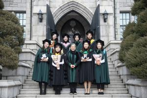 Ewha students are smiling brightly wearing the new graduation gown